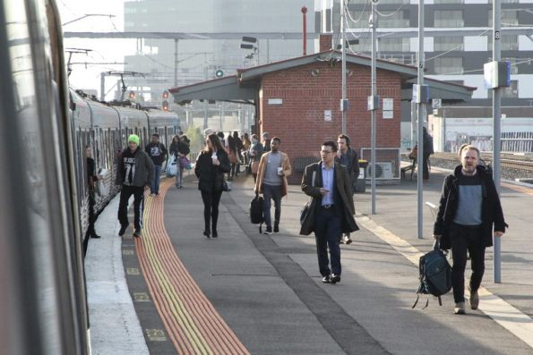 Passengers try to squeeze onboard an up Sunbury service at Middle Footscray