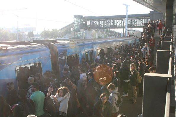 Train finally arrives at West Footscray to pick up the waiting crowds