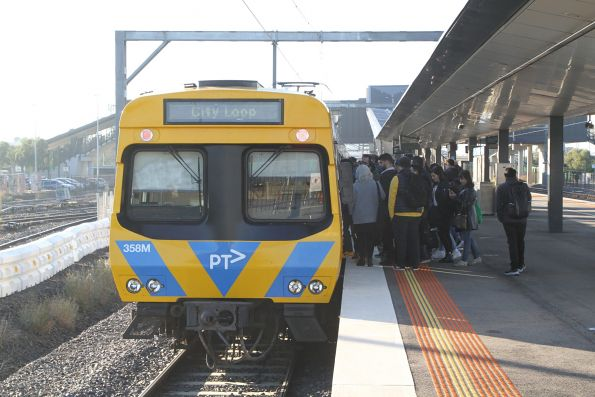 Stranded trainload of passengers finally able to board a citybound service at West Footscray