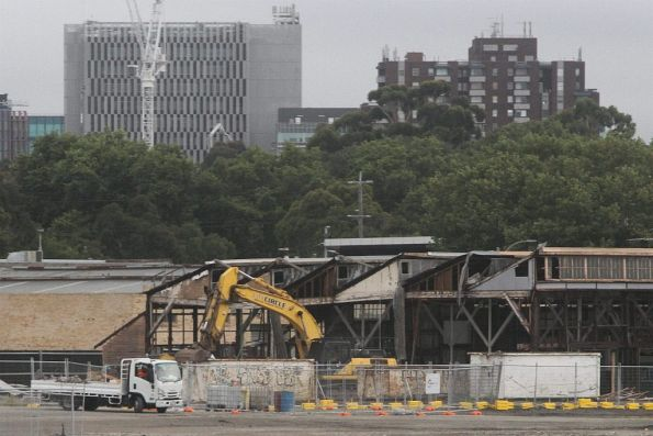 Demolishing Laurens Hall on Arden Street to make way for the future Metro Tunnel station