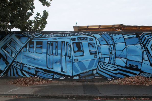 Hitachi train features on a mural outside at the Arden station work site