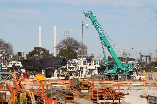 Mobile crane ready to lower a TBM into the launch box at Arden