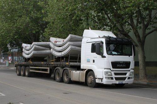 Semi trailer delivers a load of six precast concrete tunnel segments to the site