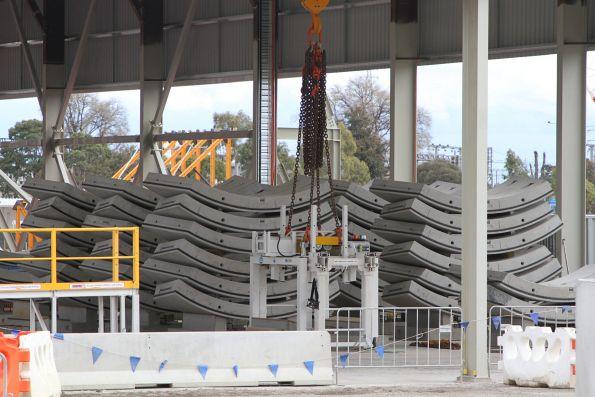 Precast concrete tunnel segments ready to be lowered into the tunnel
