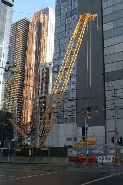 Crane lowers a skip into the shaft at La Trobe and Swanston Street