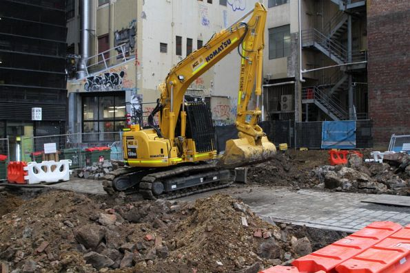 Archaeological dig completed, excavator clearing the site on Little La Trobe Street