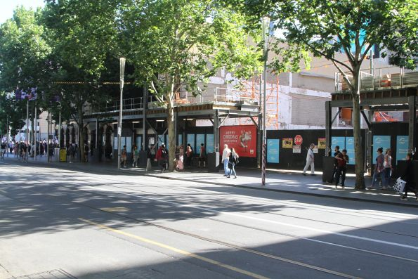 Demolishing shops on Swanston Street to make room for the future Town Hall station