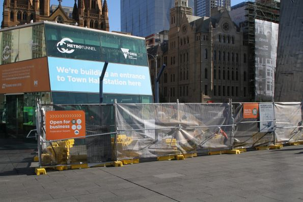 Constructing hoardings around the Metro Tunnel construction site at Federation Square