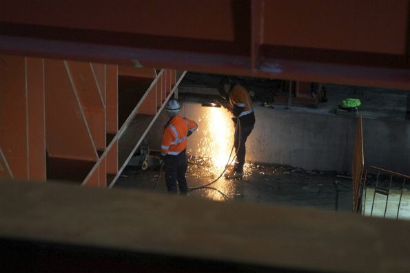Cutting steel with a gas axe at the bottom of the City Square pit