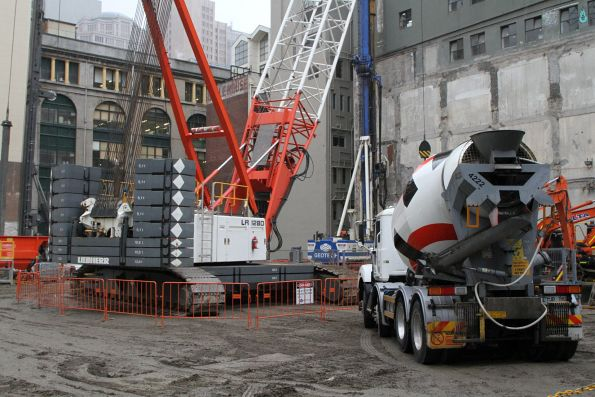 Crawler crane and cement mixer at the Young and Jacksons site