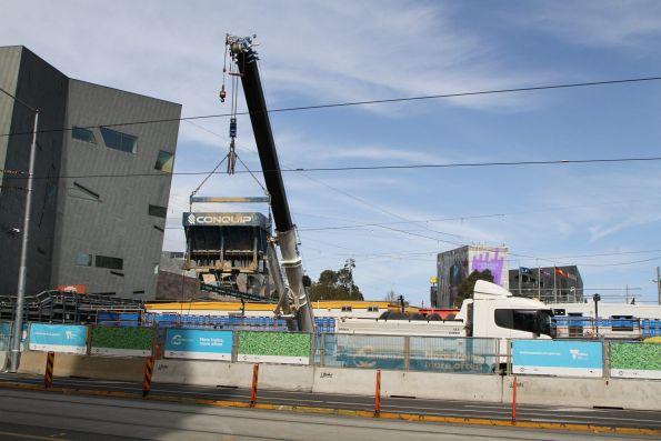 Mobile crane moves a kibble of spoil out of the Federation Square shaft