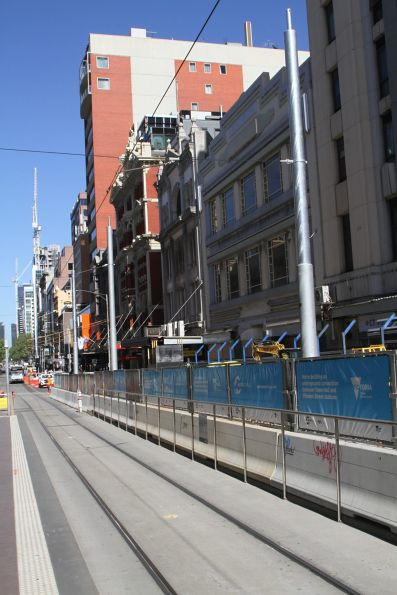 Tramway overhead on Flinders Street relocated to the edge of the tracks