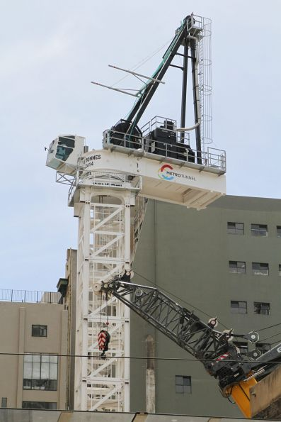 Metro Tunnel branded crane being erected at the Port Phillip Arcade work site