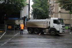 Tip truck and dog trailer exits the City Square site onto Swanston Street