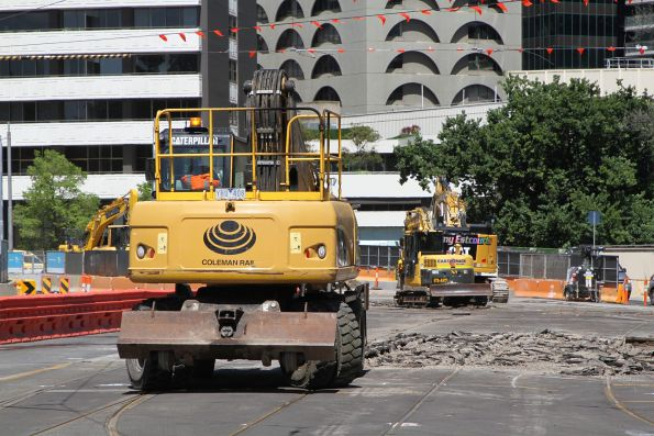 Excavators at work ripping up the St Kilda Road tram tracks at Park Street
