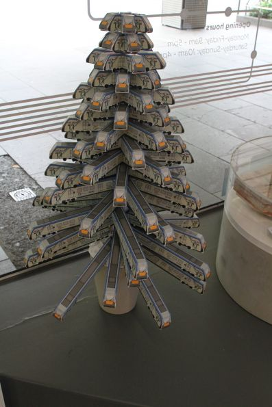 Cardboard HCMT models turned into a Christmas tree at the Metro Tunnel visitor centre