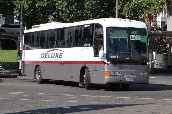 Deluxe Coachlines 2529AC departs the Arts Centre on a Frankston line rail replacement service