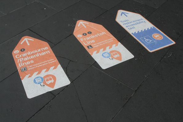 Directions to Frankston, Cranbourne and Pakenham line buses on the footpath outside Flinders Street Station