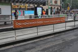 Banner with directions to Frankston, Cranbourne and Pakenham line buses on the tram stop outside Flinders Street Station