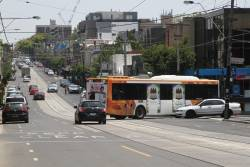 Ventura bus #1036 6464AO turns from Toorak Road into Darling Street after stopping at South Yarra station on an all stations run from Westall