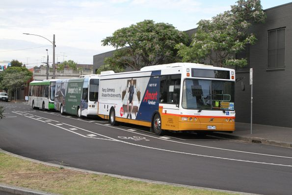 Sita bus #124 9382AO leads a row of standby buses at North Melbourne station