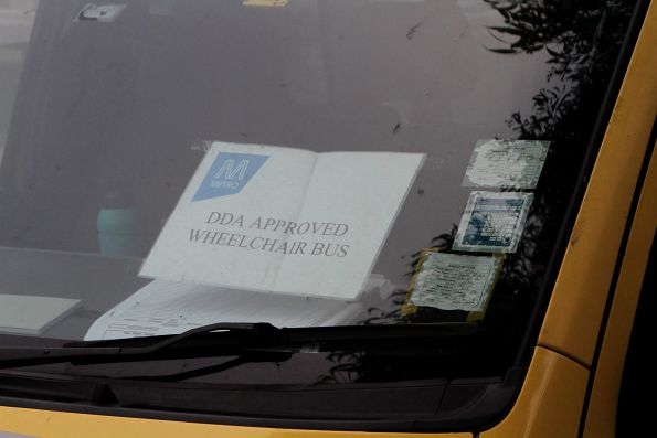 'DDA approved wheelchair bus' sign on the window of a Maxi Taxi at Newport