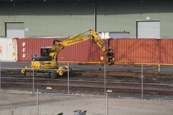 McLeod Rail hi-rail excavator at work shifting rail in the sidings at North Dynon