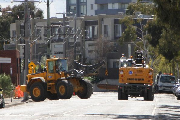 Front end loader and excavator team up to move lengths of rail along Hobsons Road
