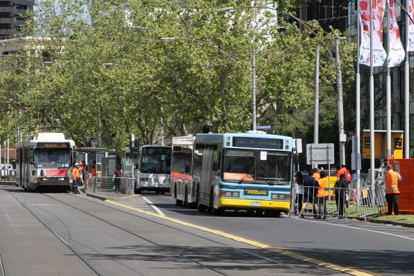 Citybound passengers change from bus to tram at the Shrine of Remembrance on St Kilda Road