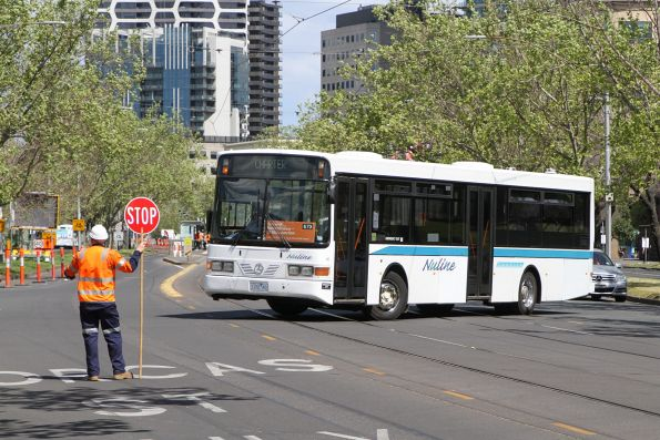Nuline Charter bus #80 1122AO does a u-turn at Anzac Avenue and St Kilda Road