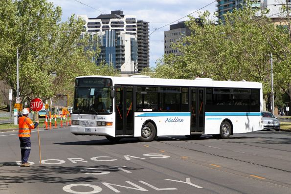 Nuline Charter bus #79 1116AO does a u-turn at Anzac Avenue and St Kilda Road