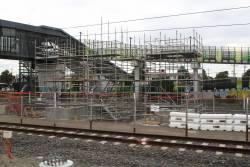 Scaffolding surrounds the pylons for the third platform steps and ramp