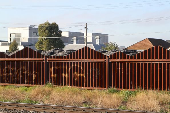 Big pile of ballast beside Buckley Street at Middle Footscray station