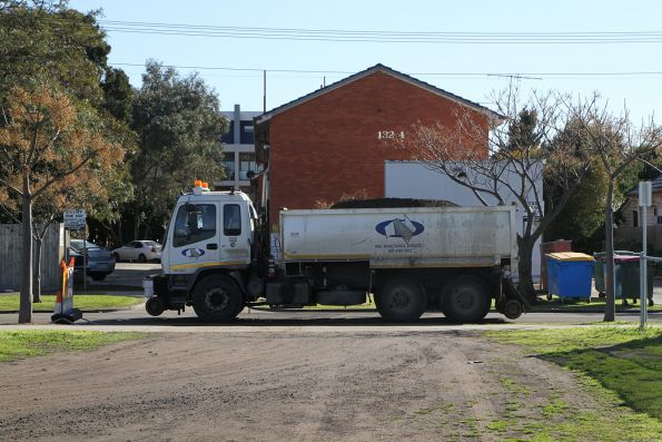 Hi-rail dump truck moving spoil through the residential streets of West Footscray