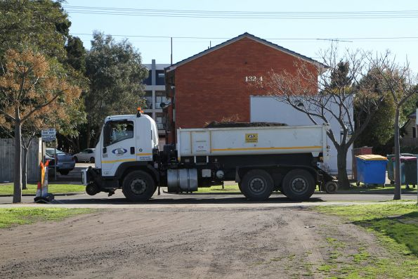 Amother hi-rail dump truck moving spoil through the residential streets of West Footscray