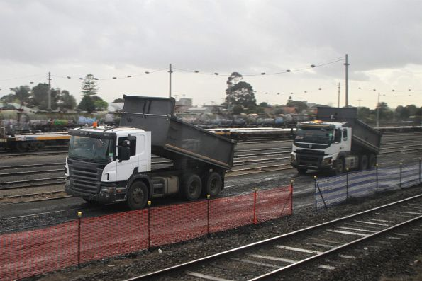 Line up of dump trucks beside Tottenham Yard