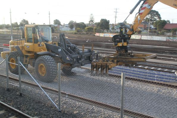Front end loader and octopus sleeper handler at work on the new siding