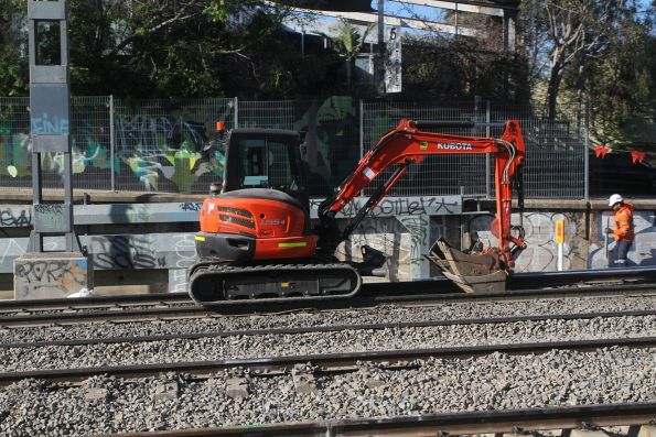 Standard excavator at work across the tracks at Middle Footscray