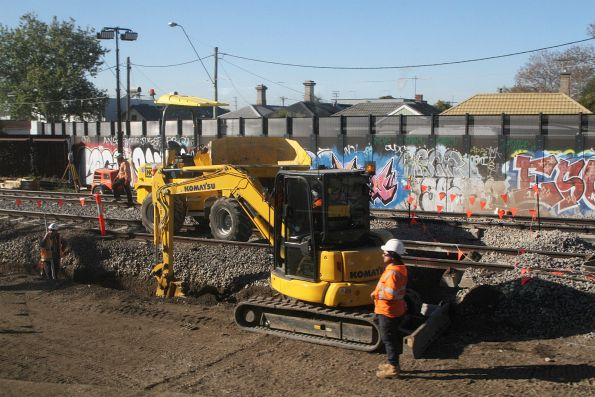 Digging trenches beneath the tracks at West Footscray