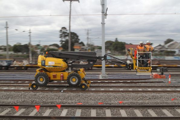 Hi-rail boom lift working on the overhead wiring on the up line at West Footscray