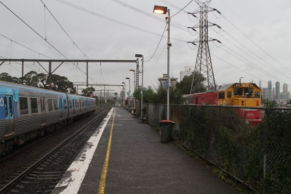 Citybound V/Line service with P11 trailing passes South Kensington on the RRL tracks