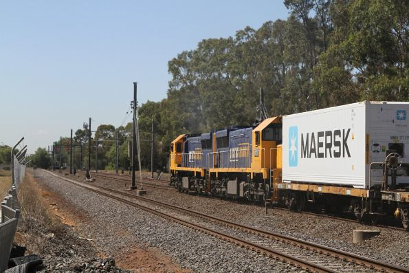 XR554 and XR551 lead the up Mildura freight through the Werribee Street level crossing in Werribee