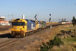 BL33, X48 and G520 leads the up Mildura freight past Tottenham