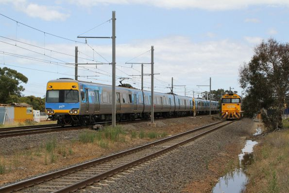 Alstom Comeng 323M runs parallel to G519 and 8130 on the up Mildura freight at Laverton