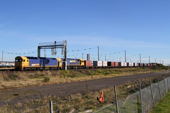BL31 and XR558 lead the up Mildura freight through Tottenham