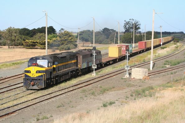 C501 leads GM36 through Gheringhap on the Portland mineral sands train