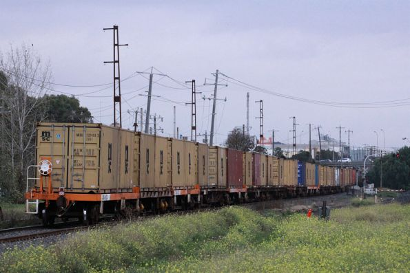 A mixed bag of wagons in the consist, including five newer orange ones, and lot of older junk