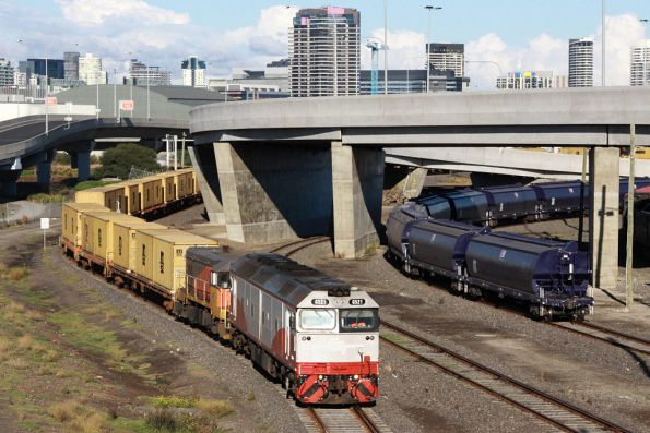 Departure from Victoria Dock, El Zorro broad gauge grain hoppers in the other siding