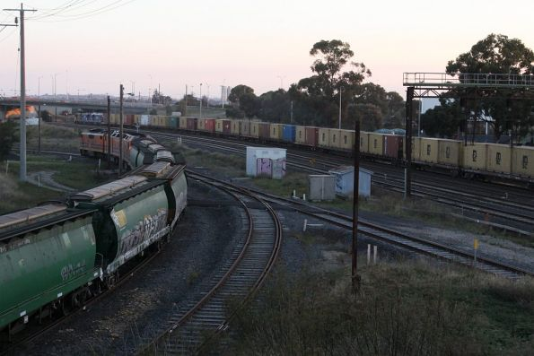 Mineral sands train heads west at North Geelong, as a GWA grain departs the grain loop