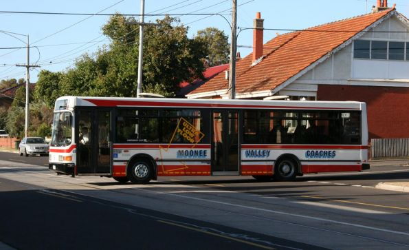 Moonee Valley Coaches bus #69 2269AO on route 506 crosses Melville Road in Brunswick West